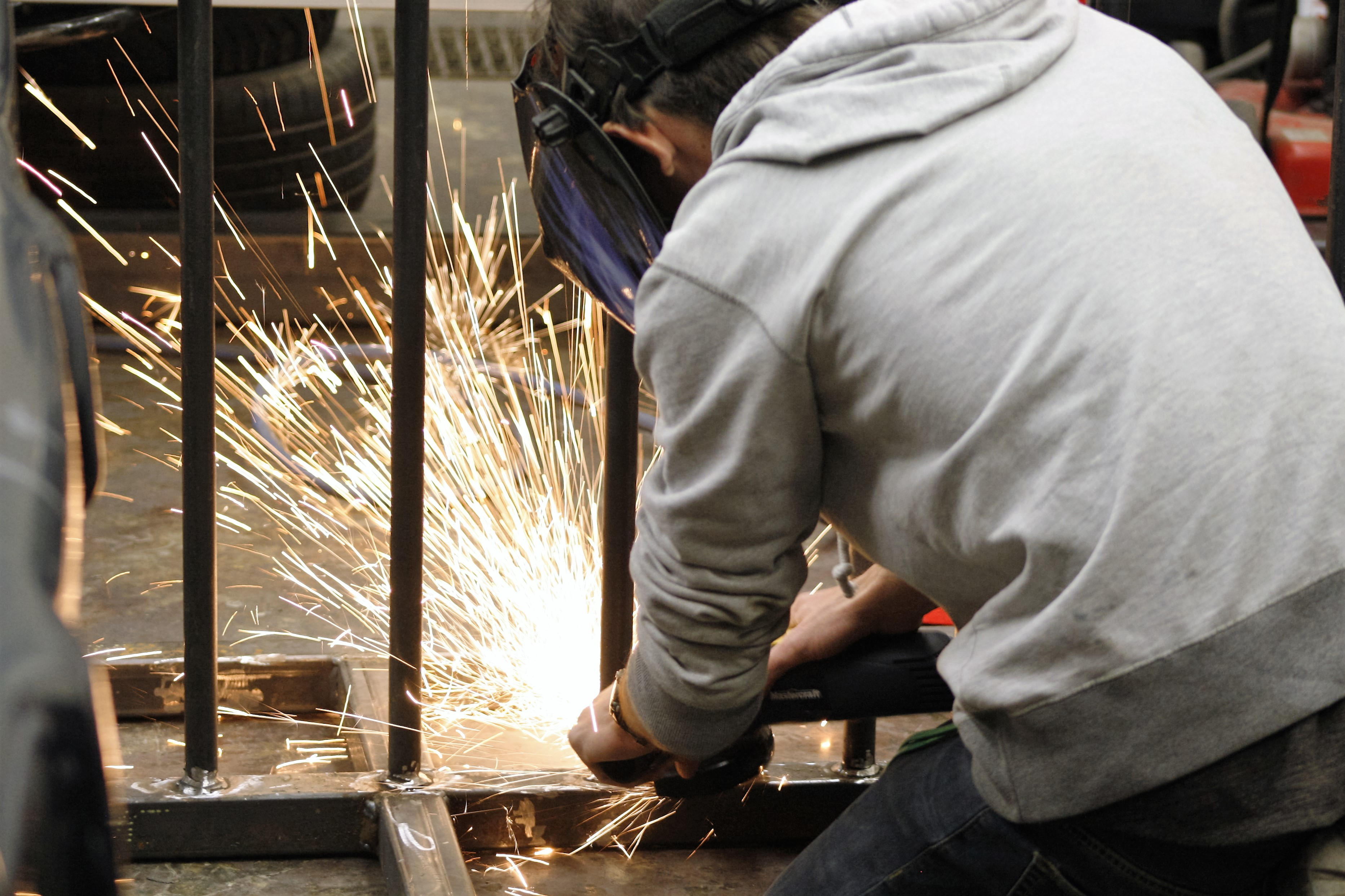 student grinding a weld