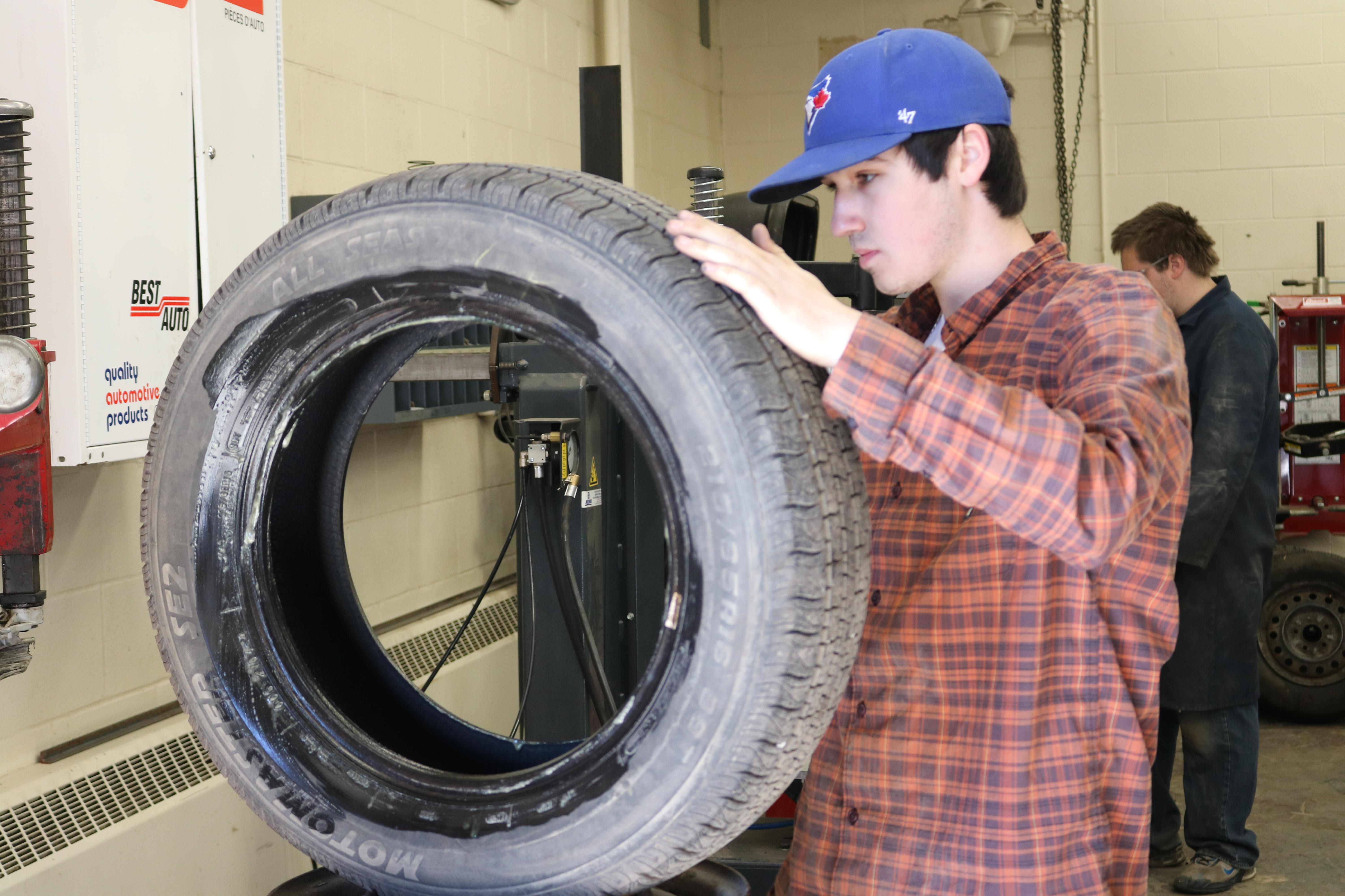 student fixing a tire