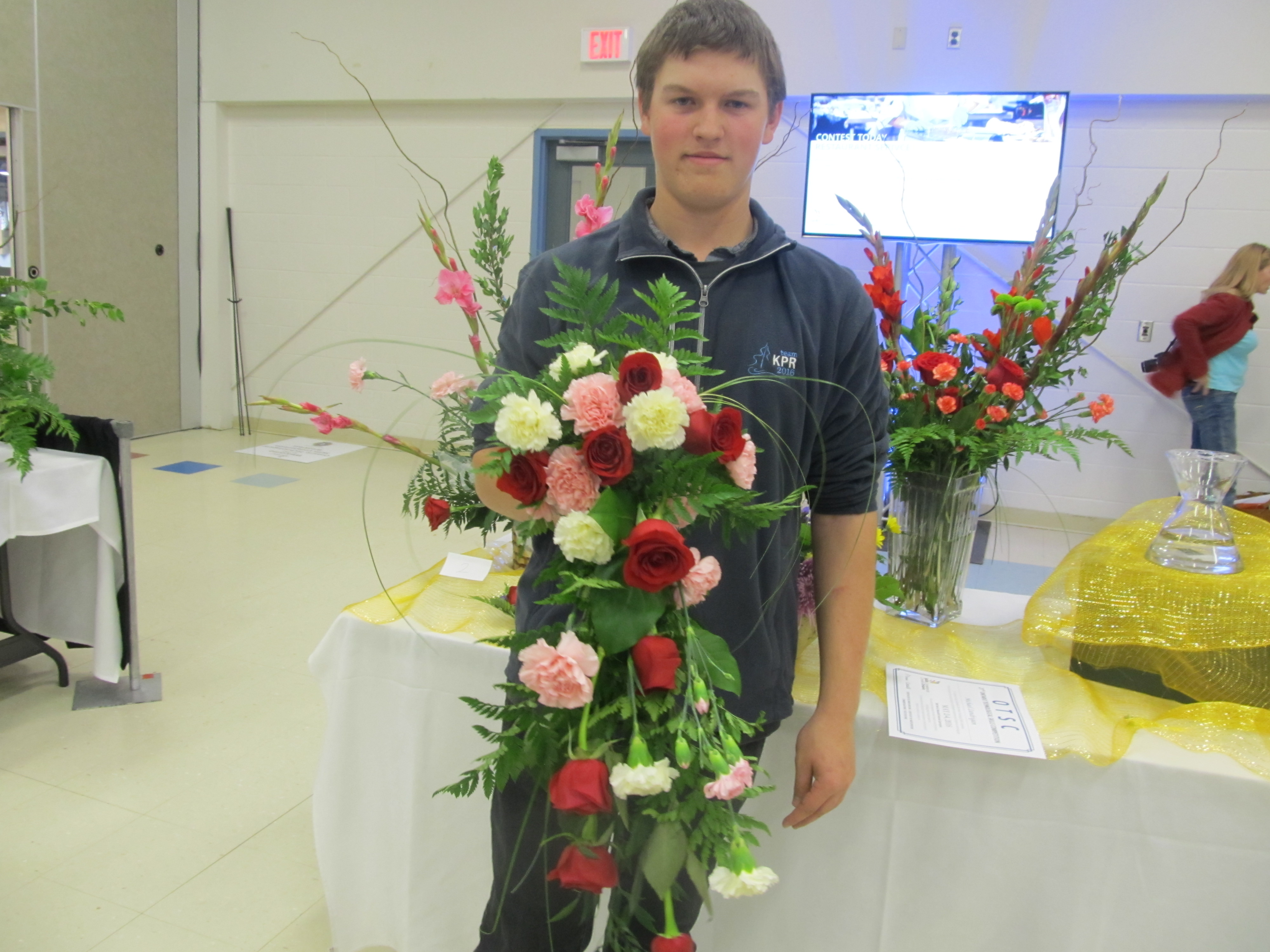 student holding flowers